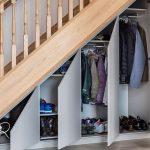 Под лестницей удобные секции для одежды